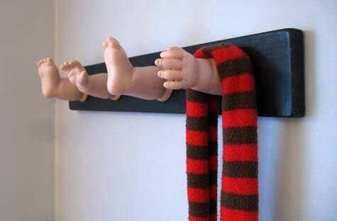 upcycled dolls limbs into coat hook
