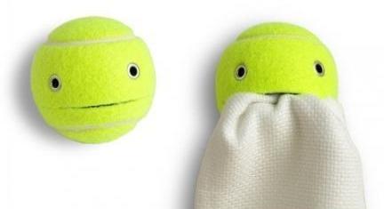 upcycled tennis balls into tea towel holder